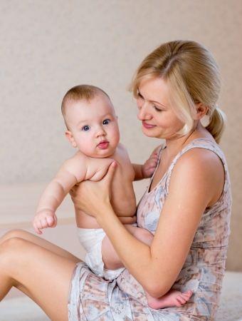 mother holding baby boy Stock Photo - 16253611