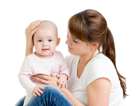 Loving mother with her baby girl on white background Stock Photo - 16521700