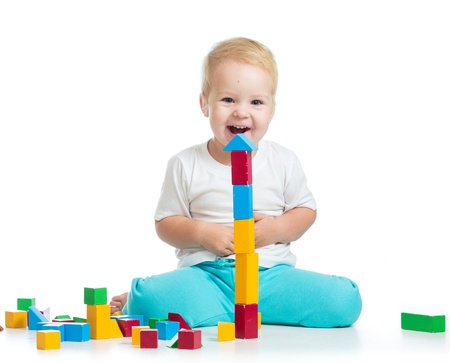 tower block: kid girl playing toy blocks  isolated on white background Stock Photo