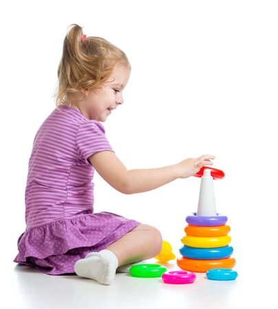 little child playing with colorful toys, isolated over white Stock Photo - 16521724