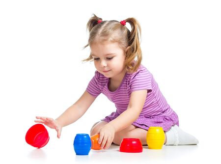 Cute child girl playing with toys isolated over white Stock Photo - 16521741