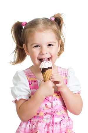ice cream cone: joyful child girl eating ice cream in studio isolated
