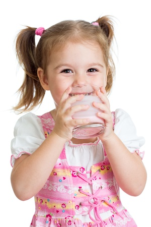 kefir: happy kid girl drinking yoghurt from glass isolated