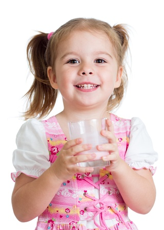 happy kid girl drinking yoghurt from glass isolated photo