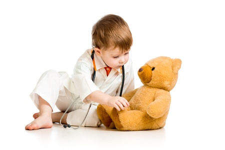 doctor toys: Adorable boy with clothes of doctor isolated on white