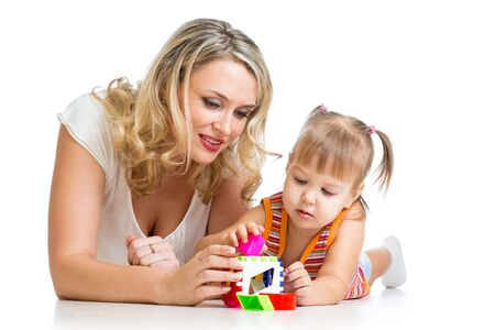 child girl and mother playing together with puzzle toy Stock Photo - 16521721