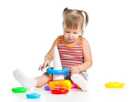 little child playing with colorful toys, isolated over white Stock Photo - 16521749