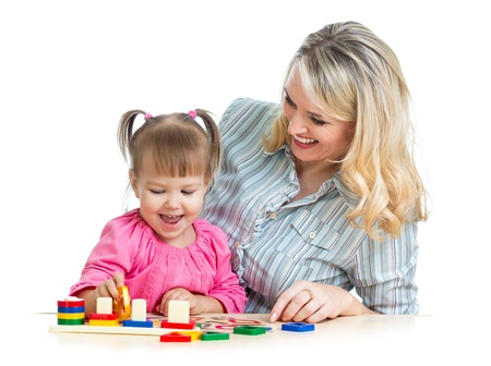 mother and her child playing with colorful puzzle toy photo