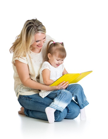 happy mother and child reading a book together Stock Photo - 16521570