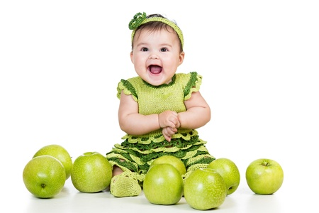 baby eating: happy baby with green apples isolated on white background Stock Photo