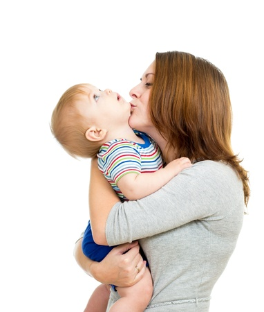 mother kissing her baby boy isolated on white photo