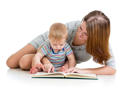 interested baby: mother reading a book her baby boy Stock Photo