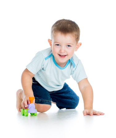 baby sitting: funny boy kid playing with toy
