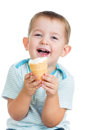 happy child boy eating ice cream in studio isolated Stock Photo - 16717457