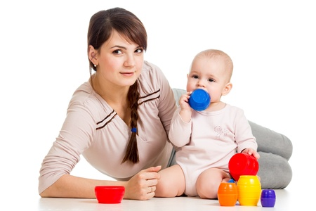 kid girl and mother playing together with cup toys Stock Photo - 16717459