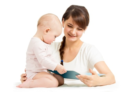happy mother and child reading a book together Stock Photo - 16727450