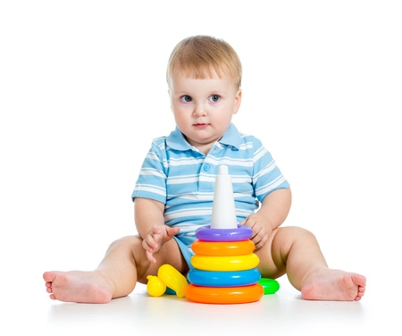 funny baby boy playing with colorful toy isolated on white photo