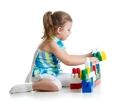 kid girl with construction set toy over white background photo