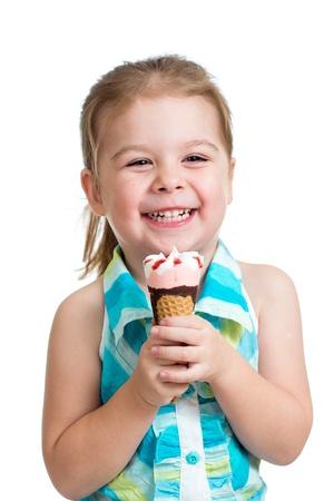 joyful child girl eating ice cream in studio isolated photo