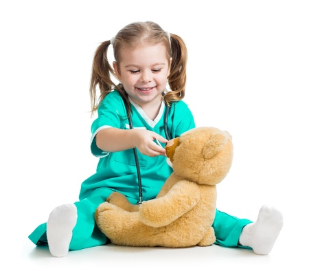 doctor s smock: Adorable child with clothes of doctor and teddy bear over white