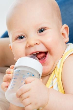 babyhood: Pretty baby boy drinking water from bottle