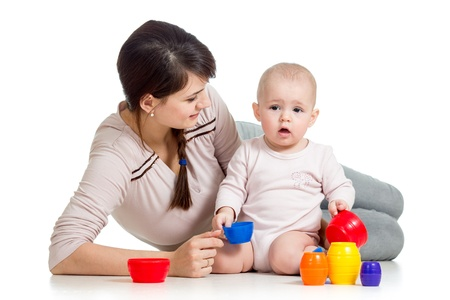 baby girl and mother playing together with colorful toys Stock Photo - 17153713
