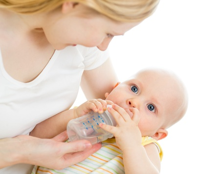 mother feeding his baby infant from bottle photo