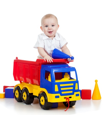 toy truck: little child playing with color toys