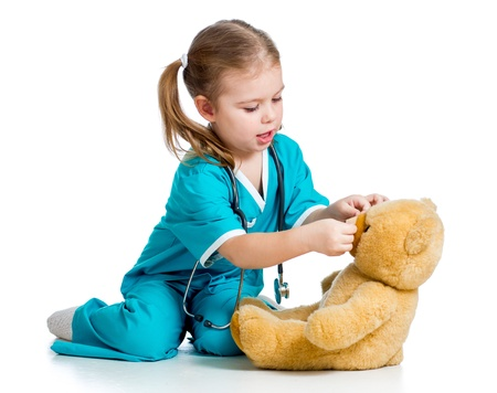 band aid: doctor girl playing and curing toy isolated on white background