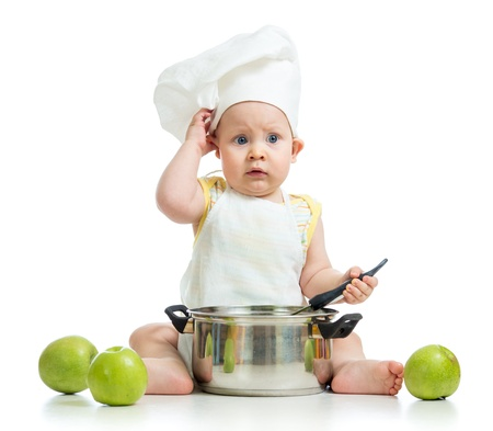 funny adorable baby with green apples isolated on white background photo