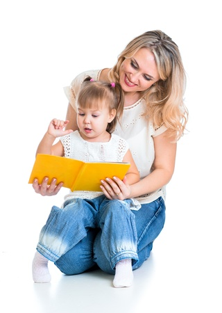happy mother reading a book to kid girl Stock Photo - 17233146