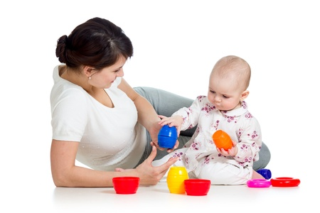 baby girl and mother playing together with colorful toys Stock Photo - 17233208