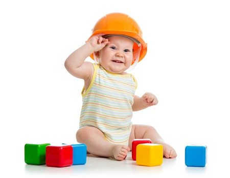 toy blocks: kid boy playing with building blocks toy