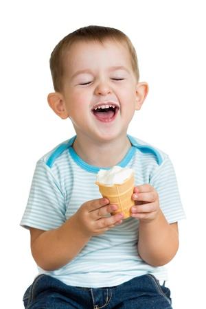 eye cream: happy kid boy eating ice cream in studio isolated Stock Photo