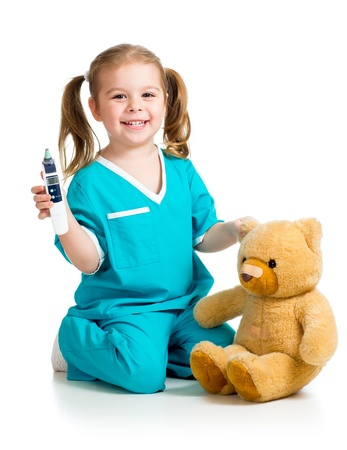 pediatrics: doctor girl playing and measuring  temperature toyl isolated on white background
