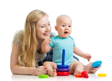 baby boy and mother playing together photo