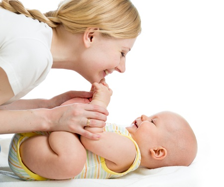 mom baby: joyful mother playing with her baby infant