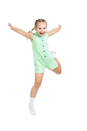 spirited: happy child girl jumping isolated on white