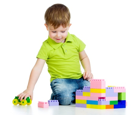 child boy playing with construction set over white background Stock Photo - 17417371