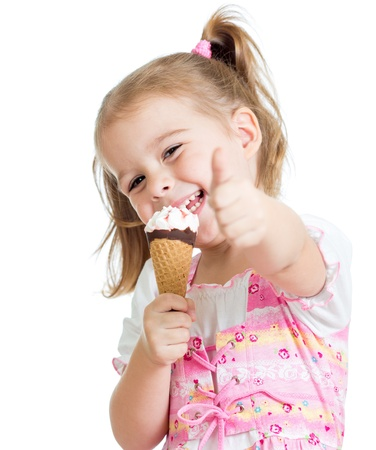 satisfied: happy kid girl eating ice cream and showing thumb up Stock Photo