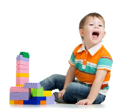 kid boy playing with construction set over white background Stock Photo - 17455471