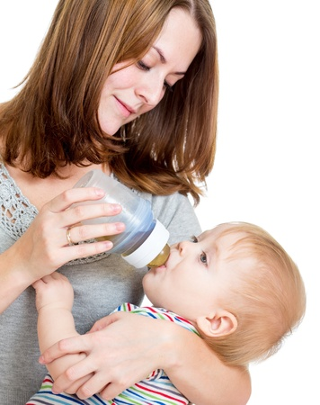 feed up: mother feeding from bottle her adorable baby