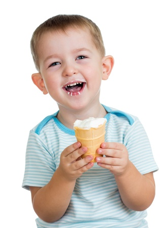 happy child boy eating ice cream in studio isolated photo