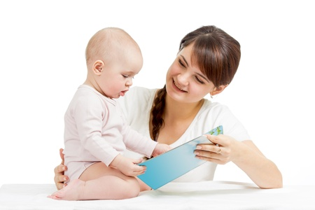 happy mother reading a book to child photo