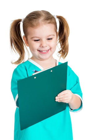 doctor s smock: Child girl uniformed as doctor writing to clipboard isolated on white background