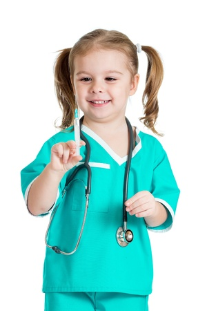 kid girl playing doctor with syringe isolated on white background photo