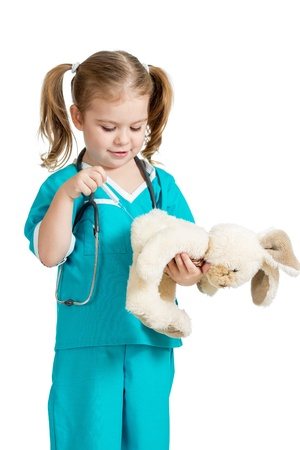 doctor s smock: Adorable child with clothes of doctor injecting hare toy over white