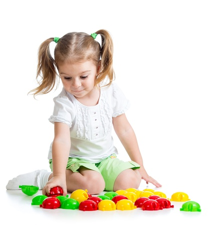 Adorable little girl playing with  mosaic toy Stock Photo - 17499569