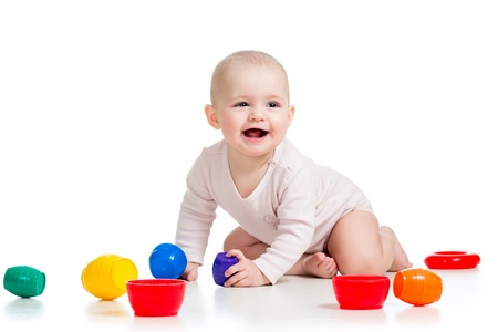 Cute baby girl playing with toys on floor, isolated over white Stock Photo - 17499567