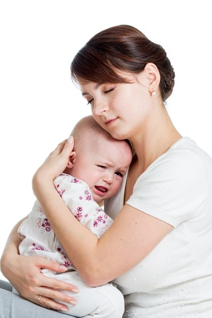 cute mother trying to comfort her crying daughter baby girl photo